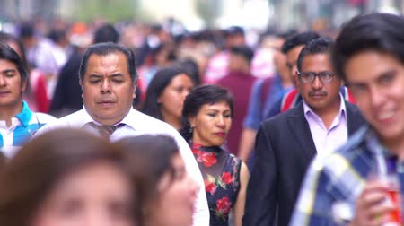 леди : Mexico City, CIRCA June 2018 SLOW MOTION-TAKE 5: Crowd walking through street. In Mexico the population growing is a public problem due the high birth rates.