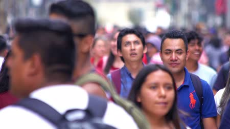 Mexico City, CIRCA June 2018 SLOW MOTION-TAKE 6: Crowd walking through street. In Mexico the population growing is a public problem due the high birth rates.