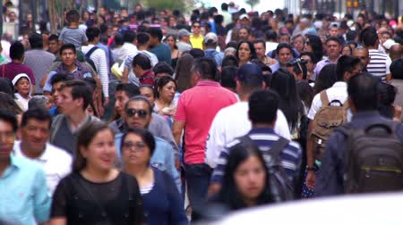 fazla : Mexico City, CIRCA June 2018 SLOW MOTION-TAKE 8: Crowd walking through street. In Mexico the population growing is a public problem due the high birth rates.