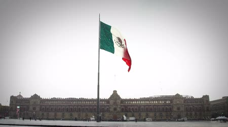 cdmx : Mexico City, MEX. 270918 (SLOW MOTION). View of The National Palace of Mexico in a rainy day, the flag flutters. Is one of the most important historic buildings in Mexico and an attractive tourist.