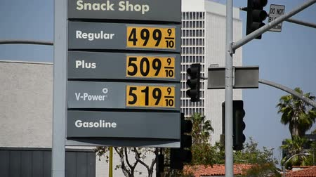pompki : High Gas Prices - LOS ANGELES - APRIL 15: Shell station sign displays high gas prices on April 15, 2012 in Los Angeles, CA.
