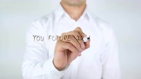 definição : Your Future Is Defined What You Do Today, Man Writing on Glass Stock Footage