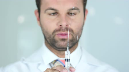 steril : Holding Injection, Close Up of Doctor in Mask Ready to inject
