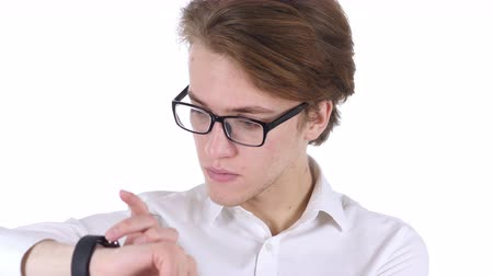 czytanie : Man in Glasses Using Smartwatch for Browsing, White Background