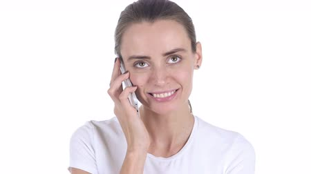 empresária : Middle Aged Womanat Work Talking on Smartphone with Customer