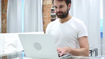 sale : Beard Man Working on Laptop while Sitting at home