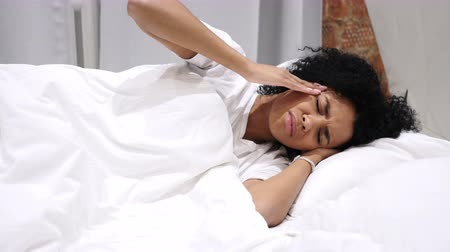 aggression : Headache, Depression, Restless Afro-American Woman Sleeping on Side Awaking from Sleep