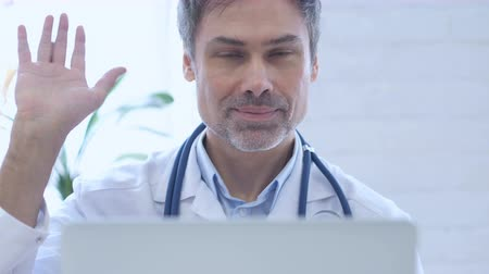 welcome sign : Hello, Doctor Waving Hand to Welcome at Work Stock Footage