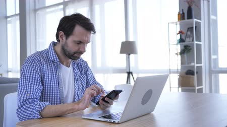 tab : Casual Beard Man Browsing Internet on Smartphone