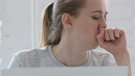 discomfort : Young Woman Coughing at Work Stock Footage