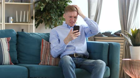 sosyal konular : Middle Aged Man Upset for Loss while Using Smartphone