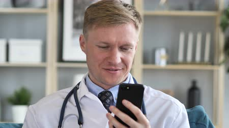 medical student : Doctor Browsing Internet on Smart Phone
