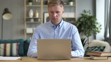 use laptop : Businessman Working On Laptop in Office