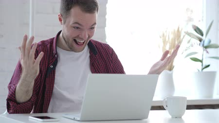 преуспевать : Excited Young Man Celebrating Success, Working on Laptop