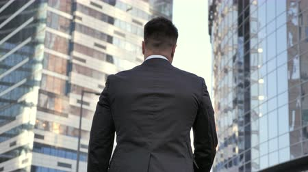bankier : Back View Of Young Businessman Wideo