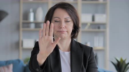 ator : Stop Gesture by Old Businesswoman, Denying Offer Stock Footage