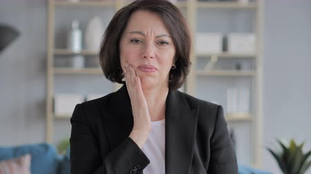 healthy office : Toothache, Old Businesswoman with Tooth Infection Stock Footage