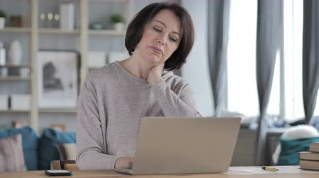 workload : Old Senior Woman with Neck Pain working on Laptop