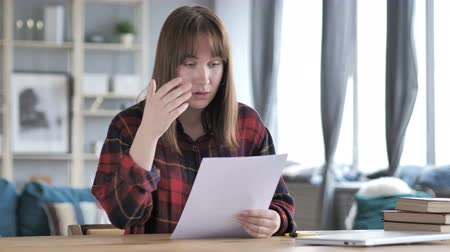 desperate student : Casual Young Girl Reacting to Failure after Reading Documents, Loss