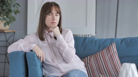 introspection : Penisve Casual Girl Thinking while Sitting on Couch