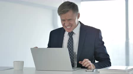 disturbed : Loss, Frustrated Businessman Working on Laptop