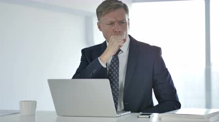 coughing : Cough, Businessman Coughing at Work Stock Footage