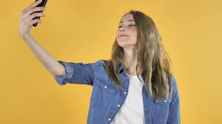 e mail address : Young Pretty Girl Taking Selfie with Smartphone on Yellow Background Stock Footage