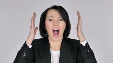 disturbed : Portrait of Screaming Businesswoman going Crazy