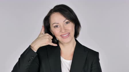 телефон доверия : Contact Us, Call me Gesture by Businesswoman, White Background Стоковые видеозаписи