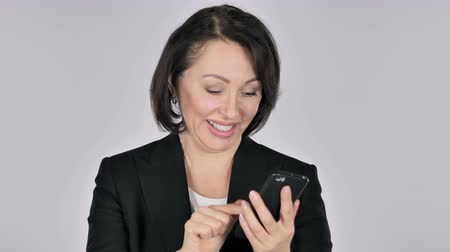 почтовый : Businesswoman Excited for Success while Using Smartphone