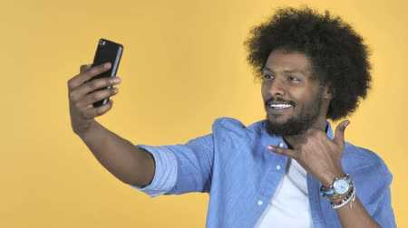 e mail address : Taking Selfie with Smartphone on Yellow Background