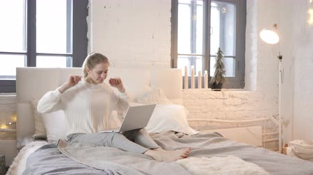 workload : Tired Girl Relaxing, Stretching Body While Using Laptop in Bed Stock Footage
