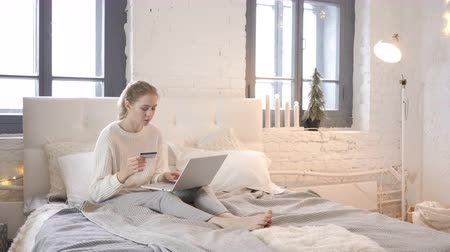 finansman : Girl Sitting in Bed Excited for Succesful Online Shopping, Payment Stok Video