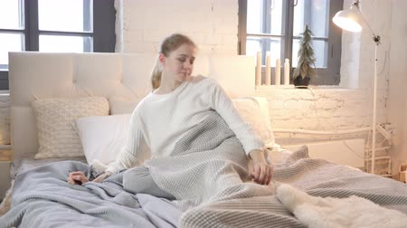 workload : Young Girl Waking Up in Morning and Stretching Her Body Stock Footage