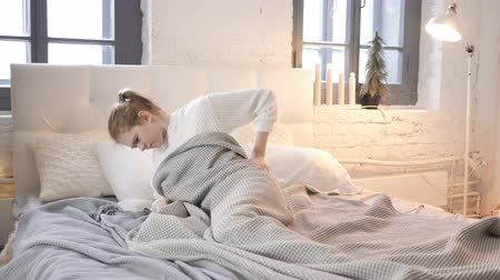 rests : Uncomfortable Sleeping Girl in Bed Stock Footage