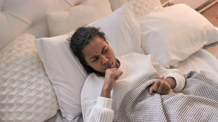 hrdlo : Young African Girl Coughing While Sleeping In Bed