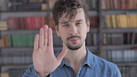 отвергать : Stop Gesture by Casual Young Man, Denying and Rejecting