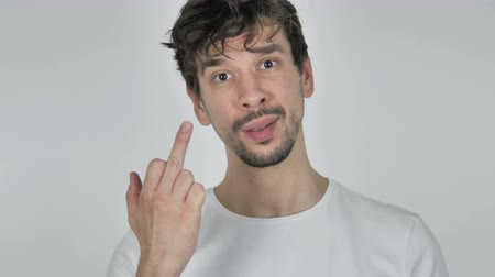 逆境 : Portrait of Young Casual Man Showing Middle Finger, White Background