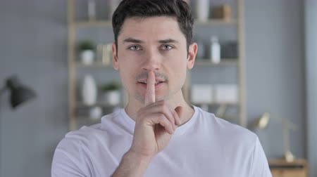 kept : Silent, Silence Gesture by Young Man