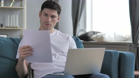 документация : Young Man Working on Documents and Paperwork