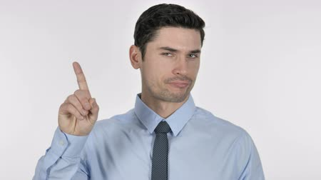актер : Portrait of Young Businessman Waving Finger to Refuse