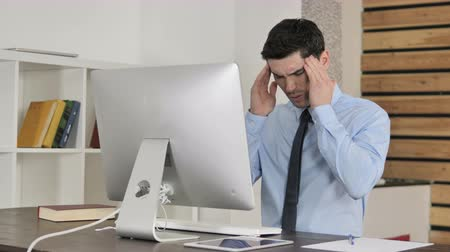 tense : Headache, Tired Young Businessman Working on Computer
