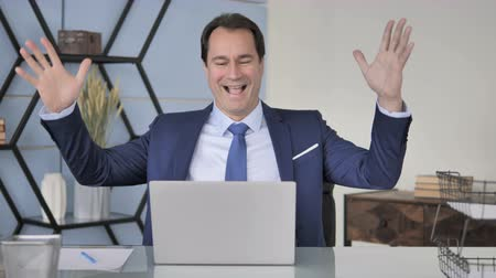 suceder : Excited Middle Aged Businessman Celebrating Success of Project