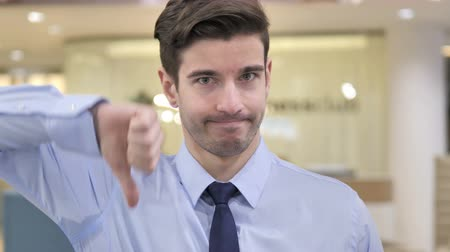 unsuccessful : Thumbs Down by Businessman