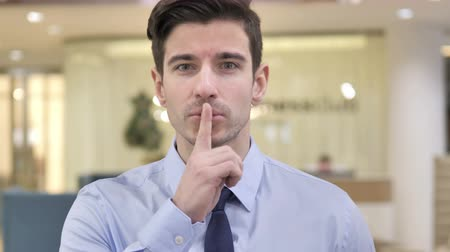 dedicado : Finger on Lips, Businessman Gesturing Silence
