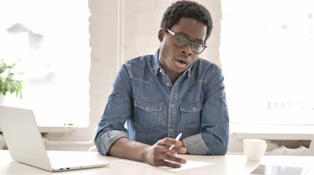 dokumentum : African Man Writing Letter