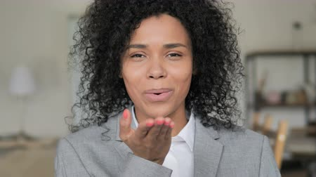 kifejező pozitivitás : Flying Kiss by Young African Businesswoman