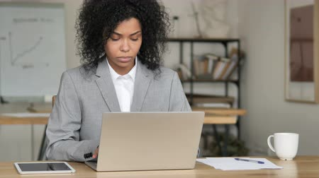 use laptop : African Businesswoman Working On Laptop