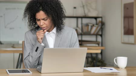 infectious : Sick African Businesswoman Coughing and Working on Laptop Stock Footage
