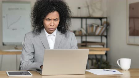 ashamed : African Businesswoman Reacting to Loss at Work Stock Footage